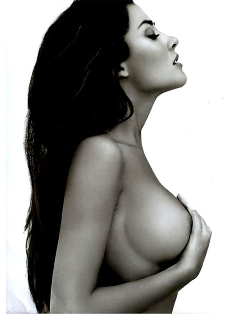 Giorgia Palmas topless but covering her nipples with her hands