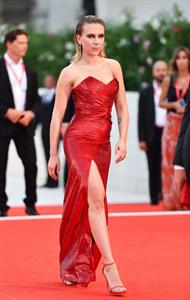 Scarlett Johansson sexy in a red dress at the Venice Film Festival.