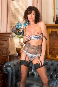 45 year old housewife Lucy Heart knows just how to keep herself busy while her husband's at work. She likes to dress up nicely in evening wear and lingerie, then take her time undressing her hot horny body. After starting off with a breast massage, she works her way down to caress her creamy soft pussy through her panties and then while it's naked as she works herself towards the climax she craves.