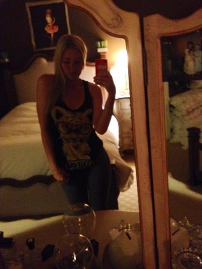 AJ Michalka taking a selfie