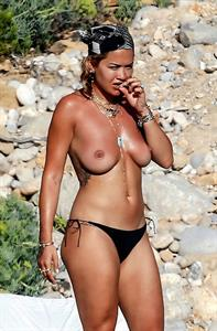 Rita Ora nude boobs seen by paparazzi as she is caught showing her topless big tits while doing a covered photoshoot.