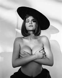 Kylie Jenner topless boobs new photo modelling in black and white holding her nude big tits.
