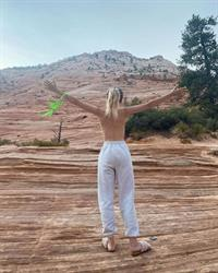 Dove Cameron topless outdoors photo protesting that public nudity is illegal telling everyone to get there tits out as she strips off her bikini top.
