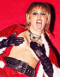 Miley Cyrus topless boobs Christmas photoshoot holding her topless big tits in sexy holiday outfits.