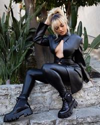 Bebe Rexha braless boobs showing nice cleavage with her big tits in a sexy tight revealing black outfit.