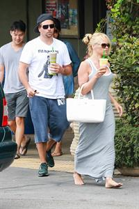 Pamela Anderson leaves barefoot a local Restaurant with a friend in Malibu July 6, 2013